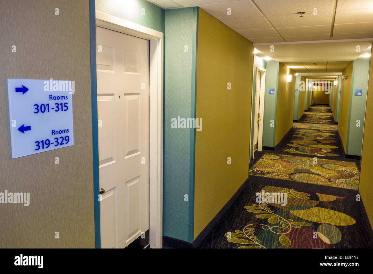 Clermont Florida Holiday Inn Express motel hall hallway guest room doors door sign directions & Clermont Florida Holiday Inn Express motel hall hallway guest room ...