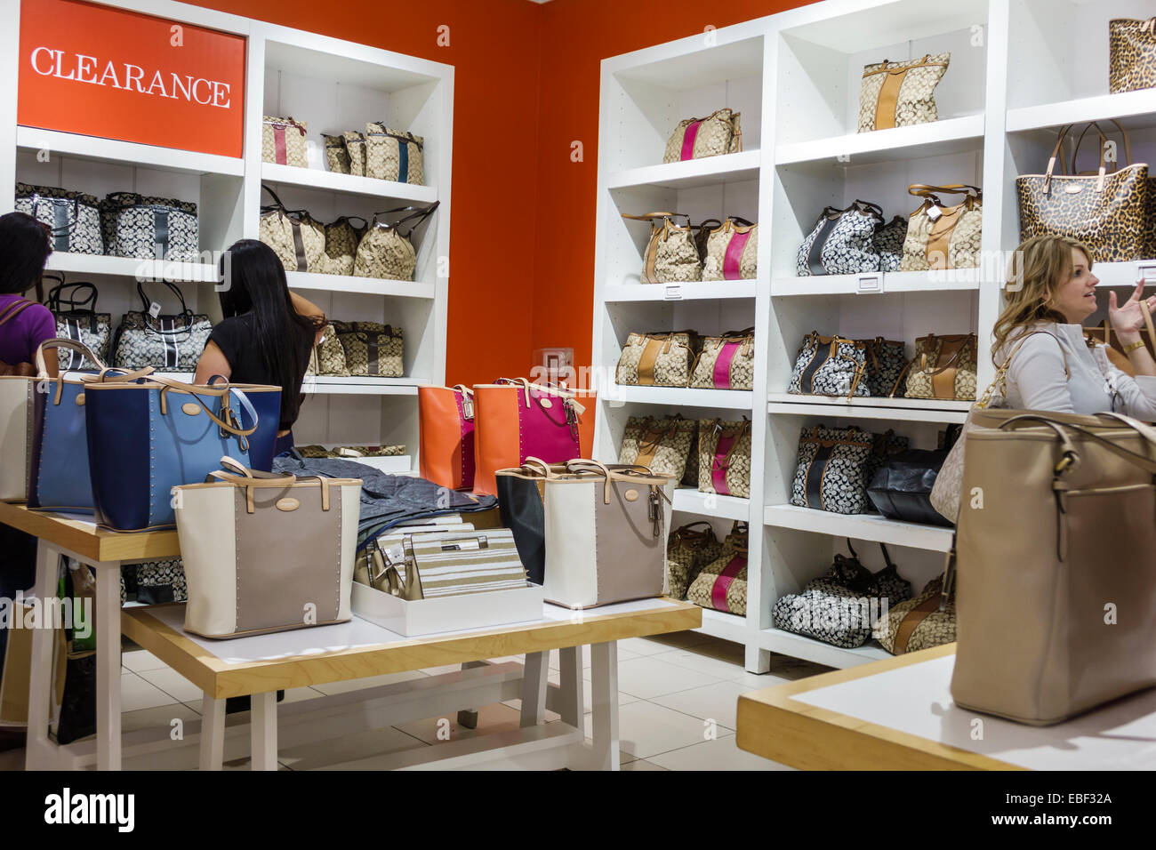 coach sale outlet 3gq5  Orlando Florida Premium Outlets shopping Coach Factory leather goods  display sale women's handbags inside clearance promotion