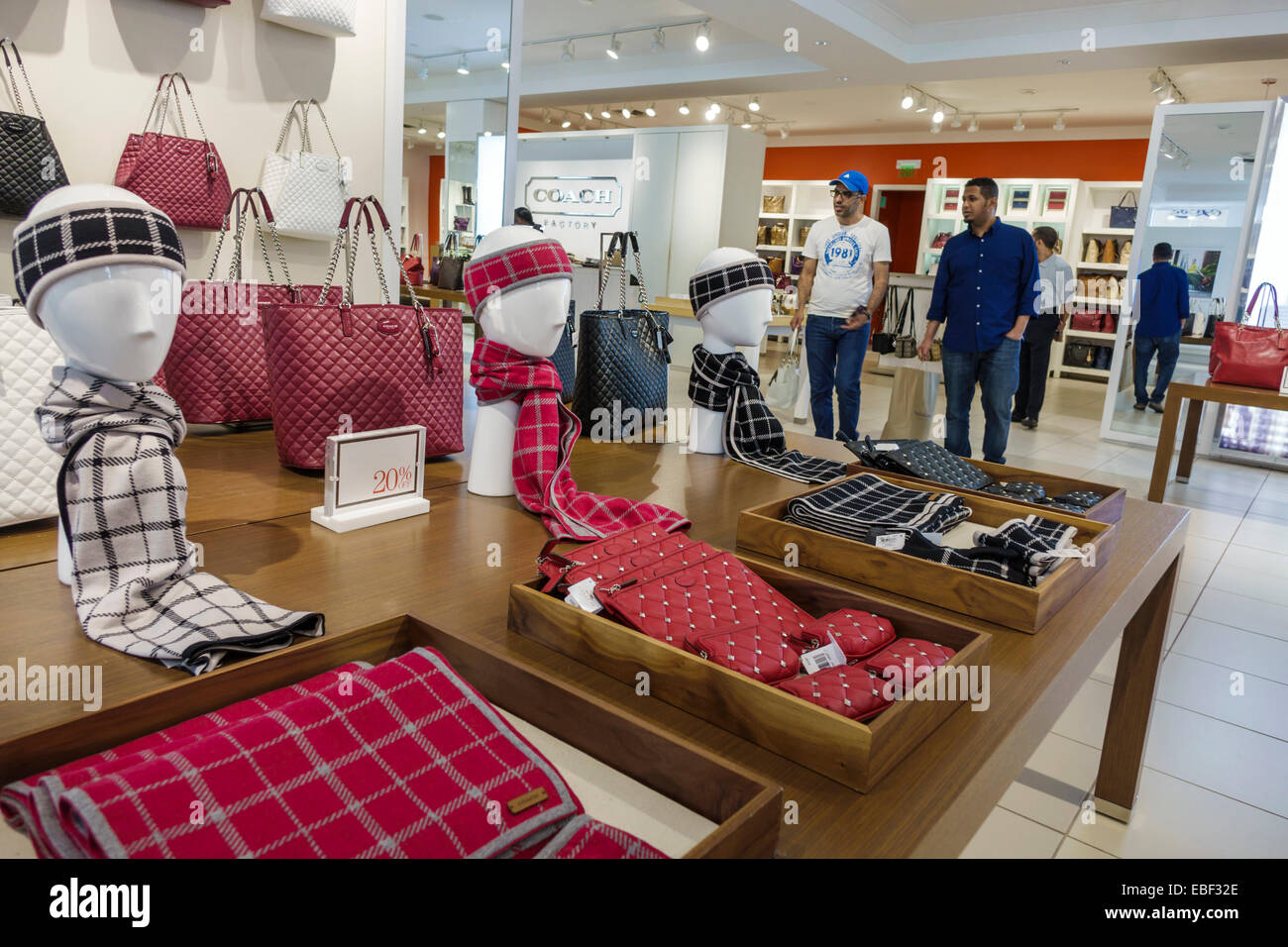 factory coach outlet 0lv0  Orlando Florida Premium Outlets shopping Coach Factory leather goods  display sale women's handbags inside scarves