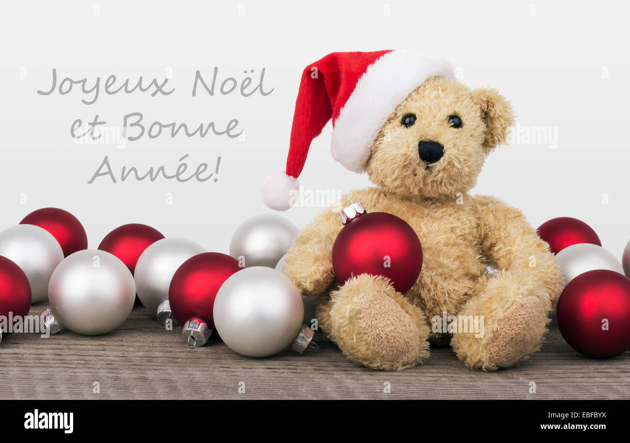 french christmas card with teddy bear and text merry christmas and a happy new year