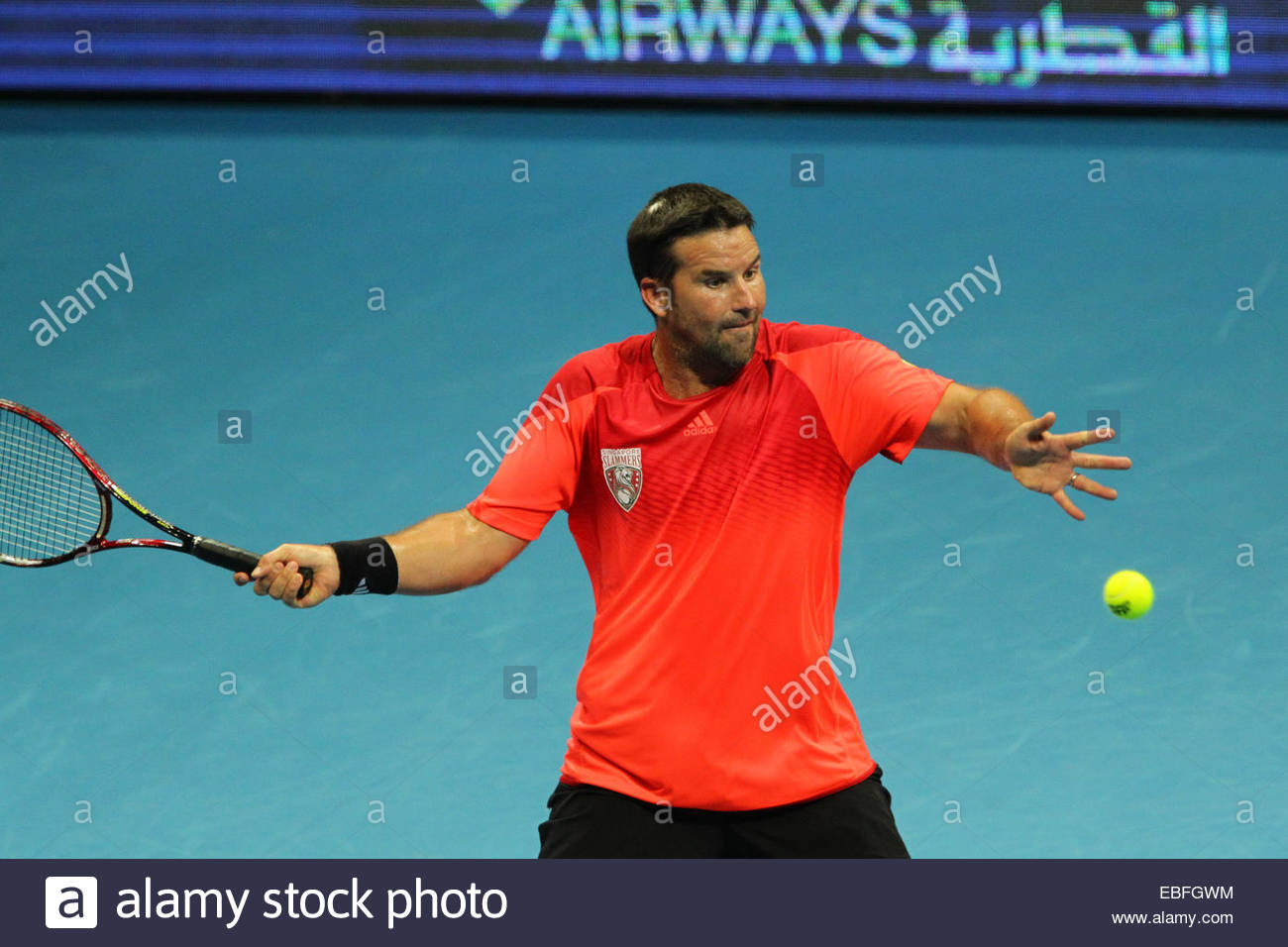 Patrick Rafter the Singapore Slammers makes a forehand return to