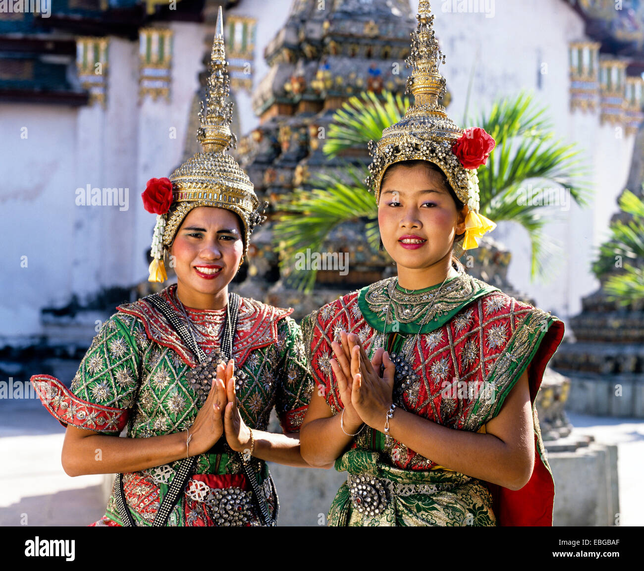 Temple dancers at wat pho displaying the wai a thai gesture of temple dancers at wat pho displaying the wai a thai gesture of greeting two young women wearing traditional dance costumes kristyandbryce Images