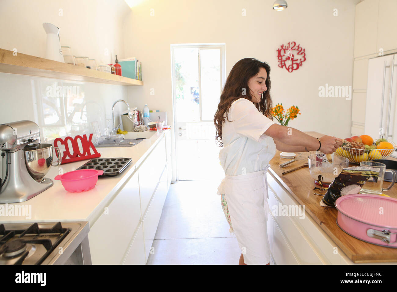 White apron girl - Stock Photo Teenage Girl In White Apron Baking Cake In Kitchen