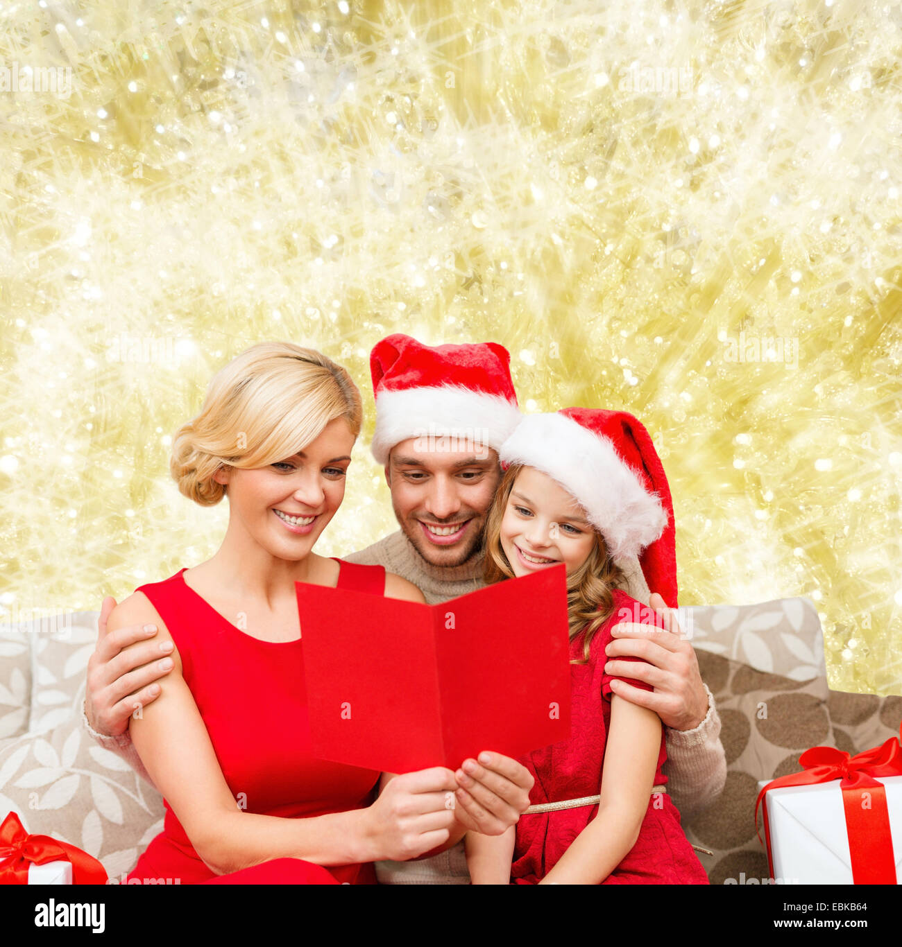 Happy Family In Santa Hats With Greeting Card Stock Photo Royalty