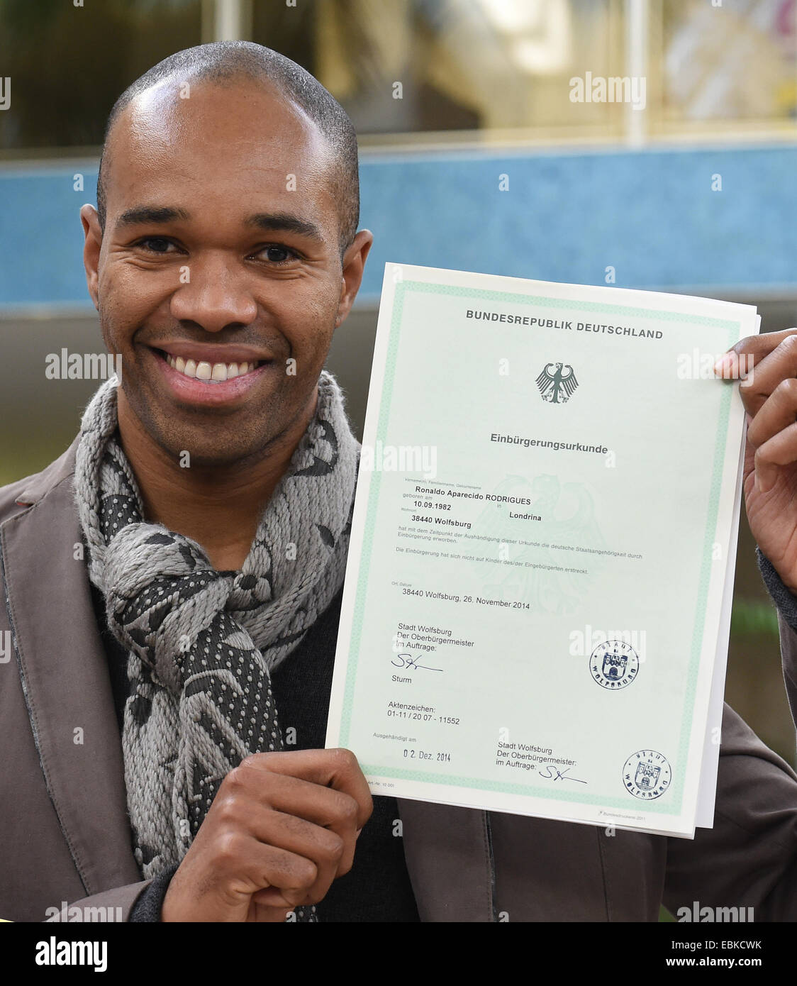 Wolfsburg germany 02nd dec 2014 naldo the brazilian defender naldo the brazilian defender from vfl wolfsburg shows off his certificate of naturalization in wolfsburg germany 02 december 2014 the 1betcityfo Choice Image