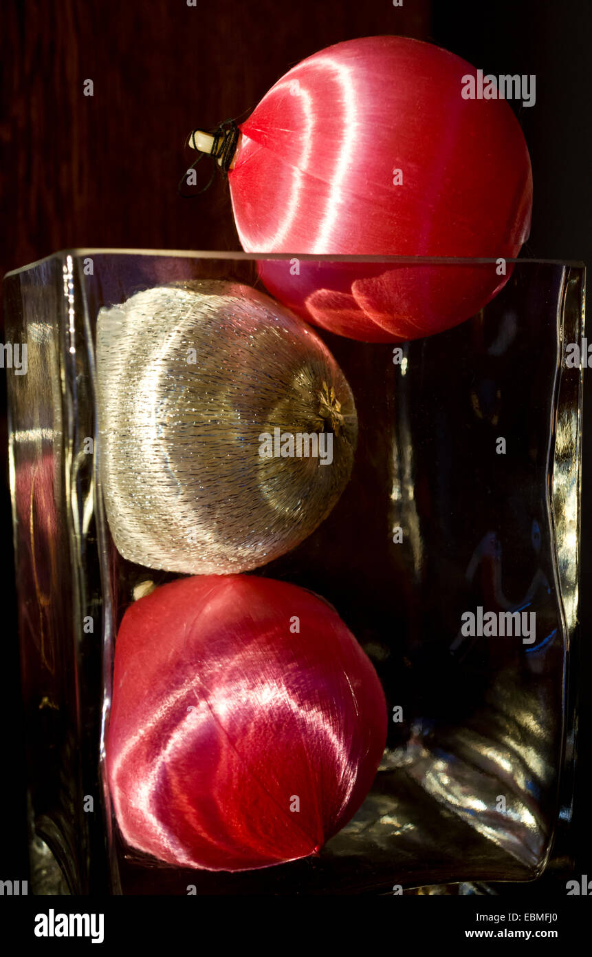 Colourful pink and silver satin Christmas ball decorations in a ...