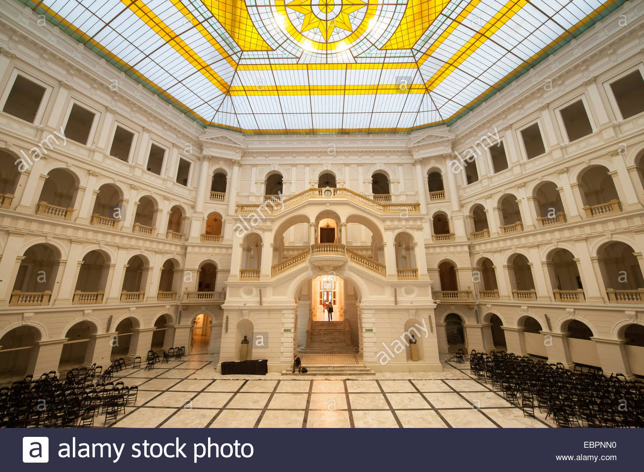 Interior auditorium with arched multi-tiered levels and glass ceiling, Warsaw  Technical University,