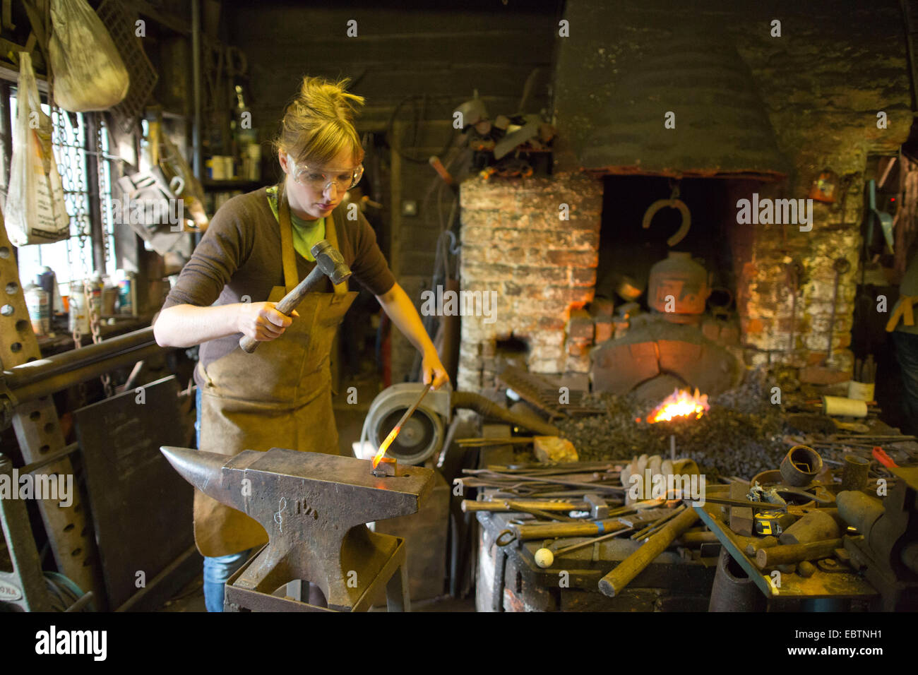 Blue apron ebt - Woman Blacksmith Working In A Forge Much Hadham Herfordshire England Uk