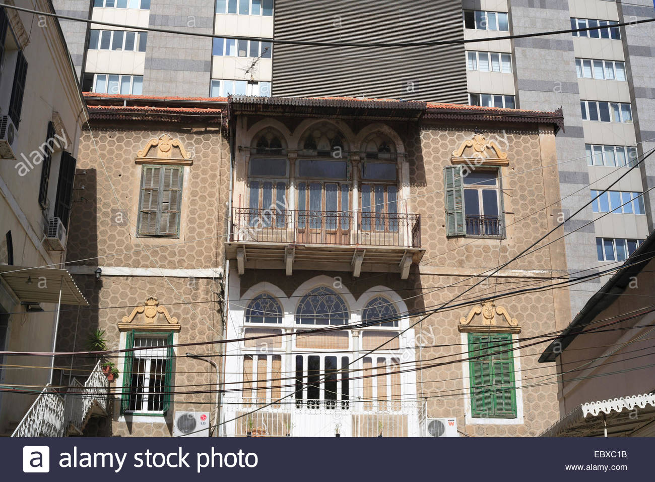 Old house in front of modern high rise building lebanon for Modern house lebanon