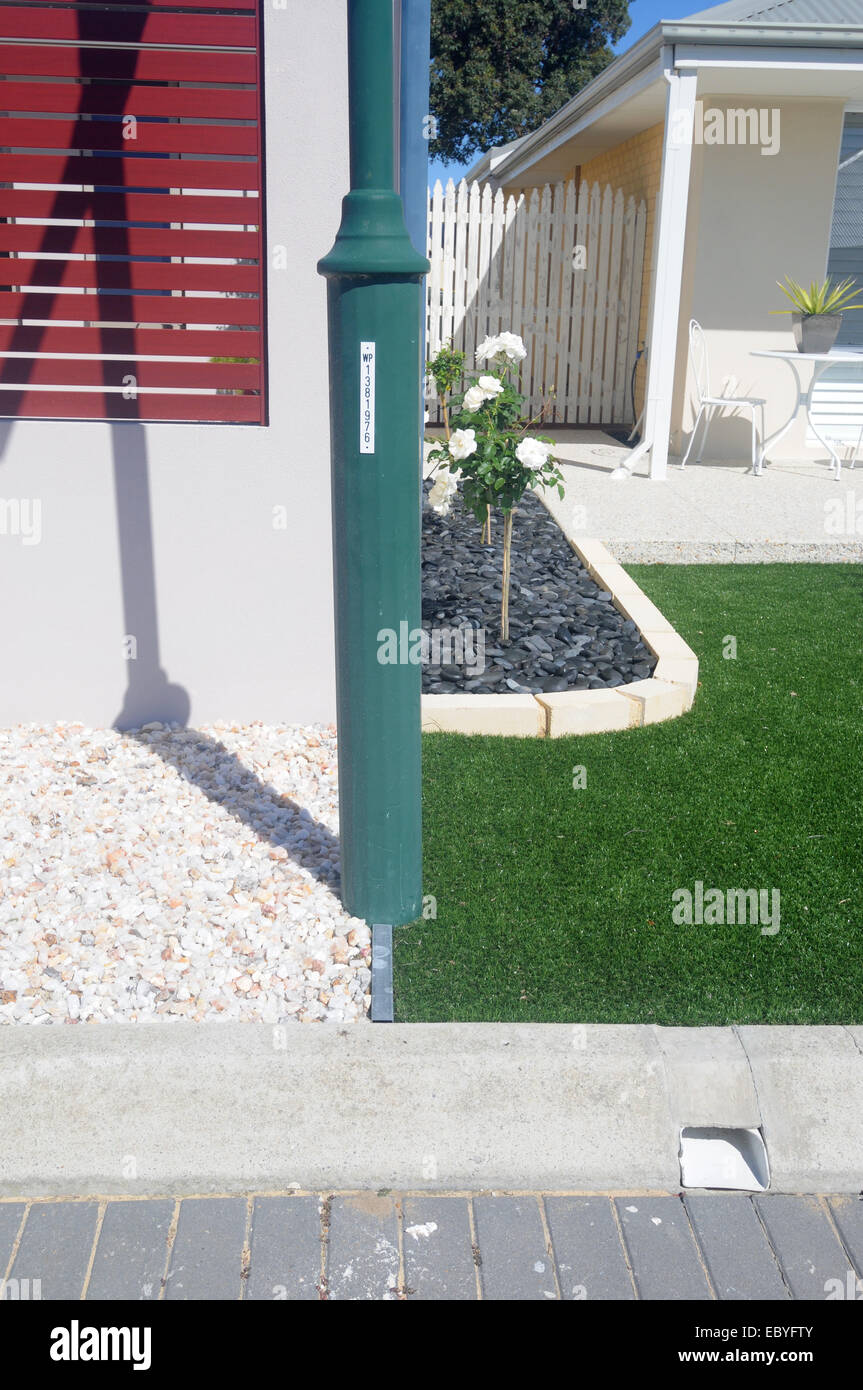 Two alternative solutions to front lawns when there are garden water ...