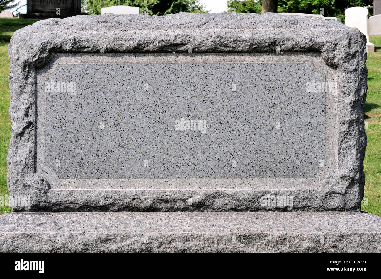 A blank tombstone in a cemetery setting Stock Photo ...