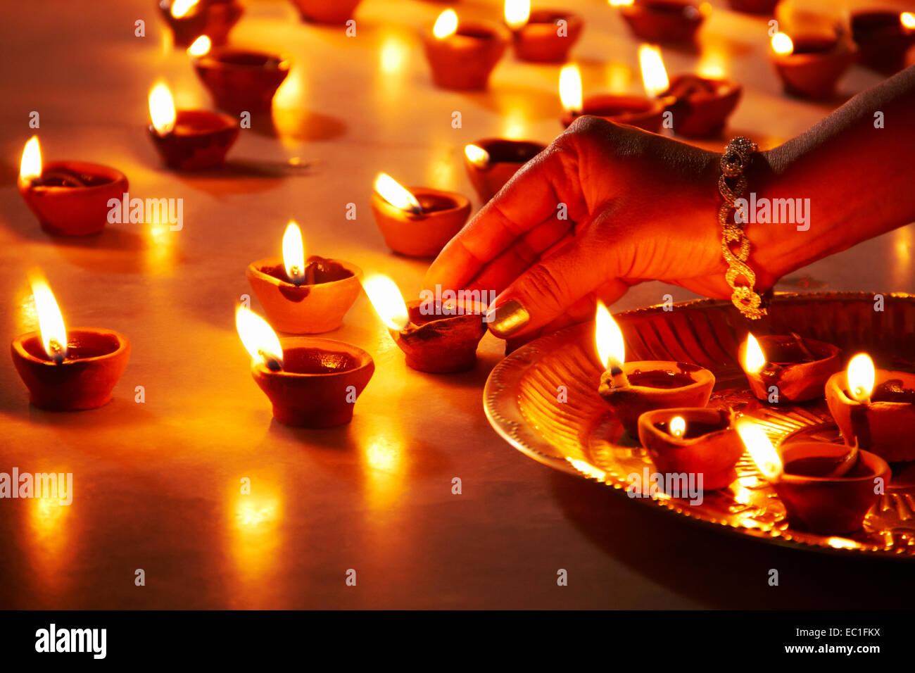 1 indian lady festival diwali home arranging diya worship stock