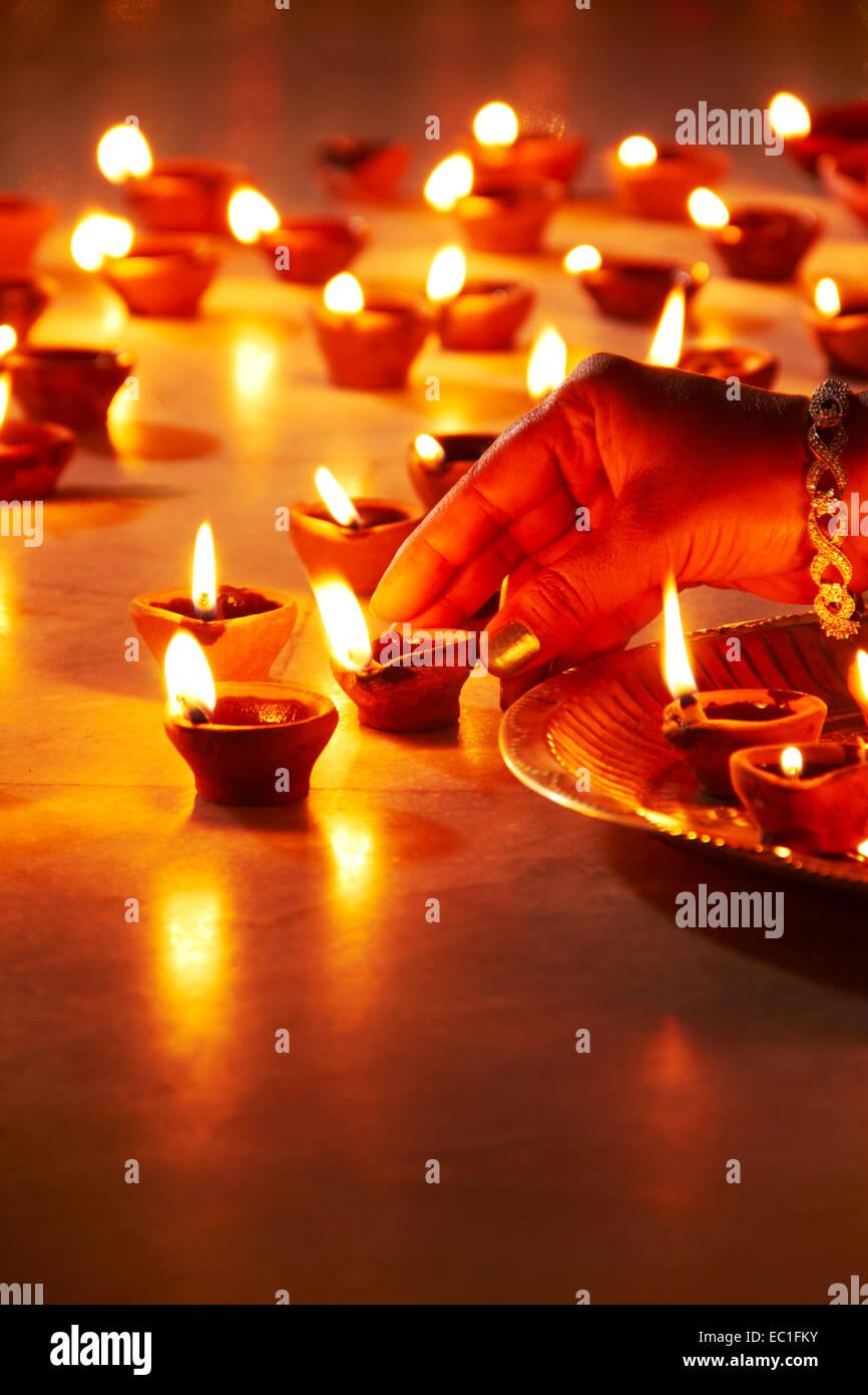 1 indian lady festival diwali home arranging diya worship for Indoor diwali decoration