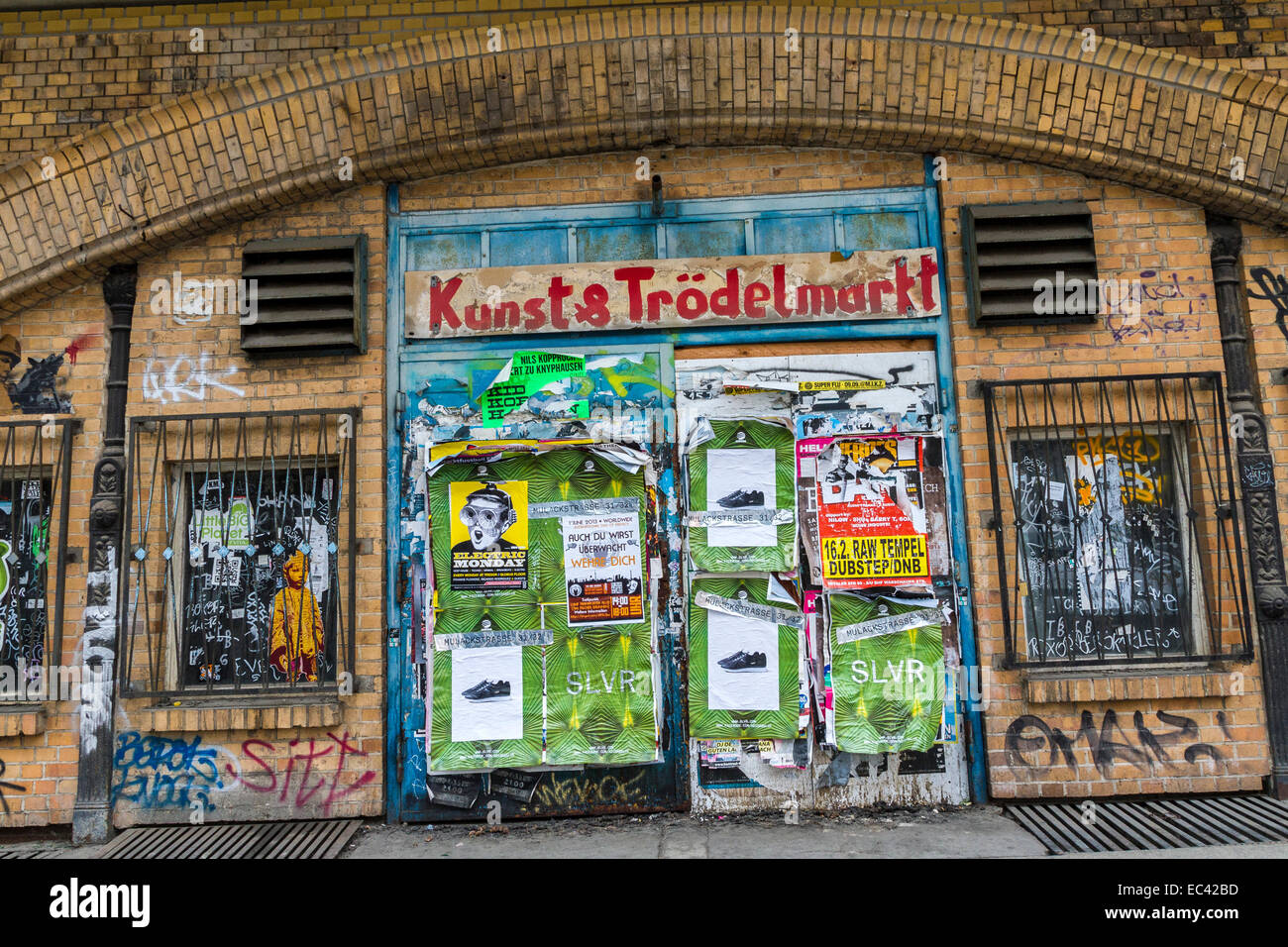 Stock photo with posters and graffiti spotted house wall in the center of berlin