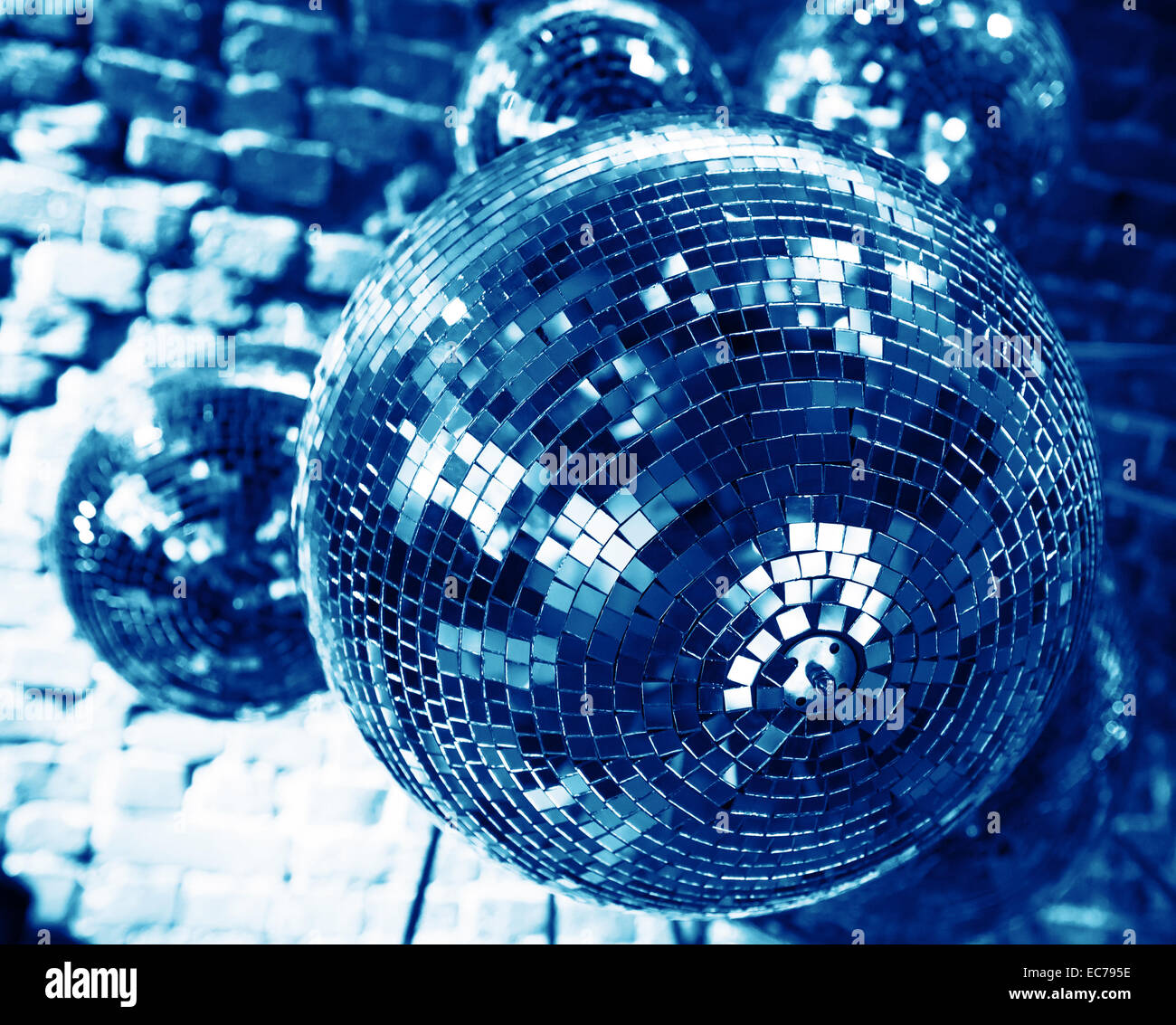 blue disco party background with mirror balls reflecting