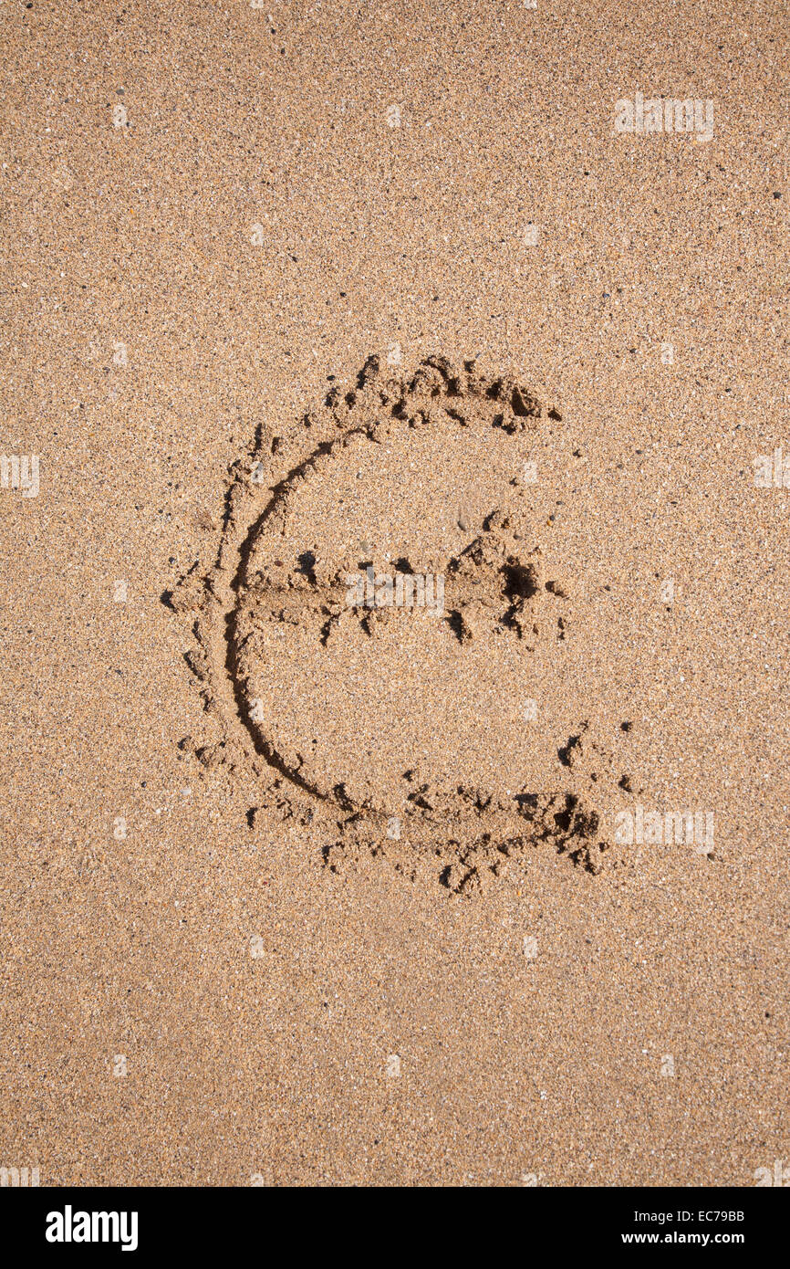 Euro symbol written on brown sand ground low tide beach ocean euro symbol written on brown sand ground low tide beach ocean seashore in spain europe biocorpaavc