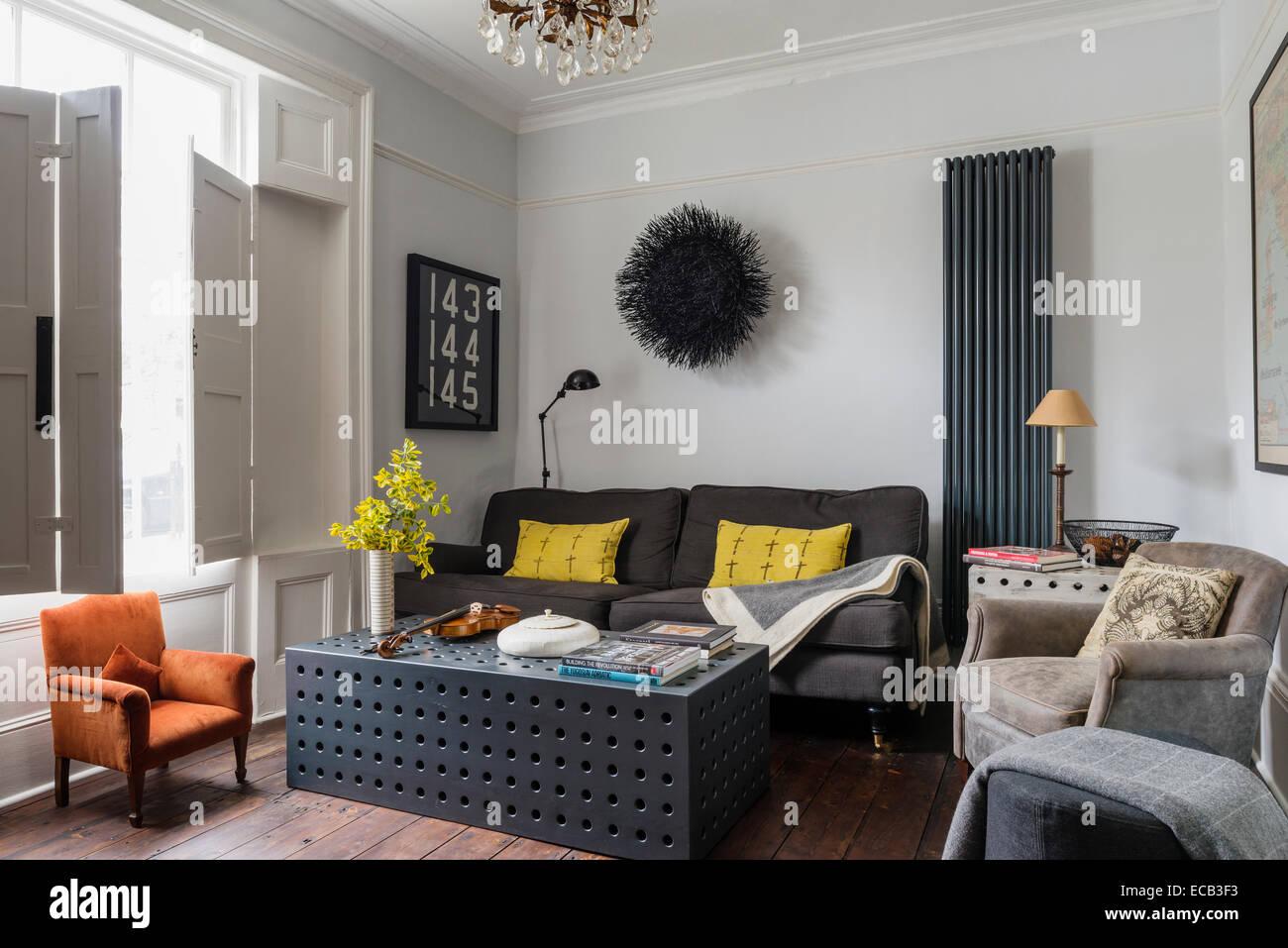 Stylish sitting room with original window shutters. The coffee ...