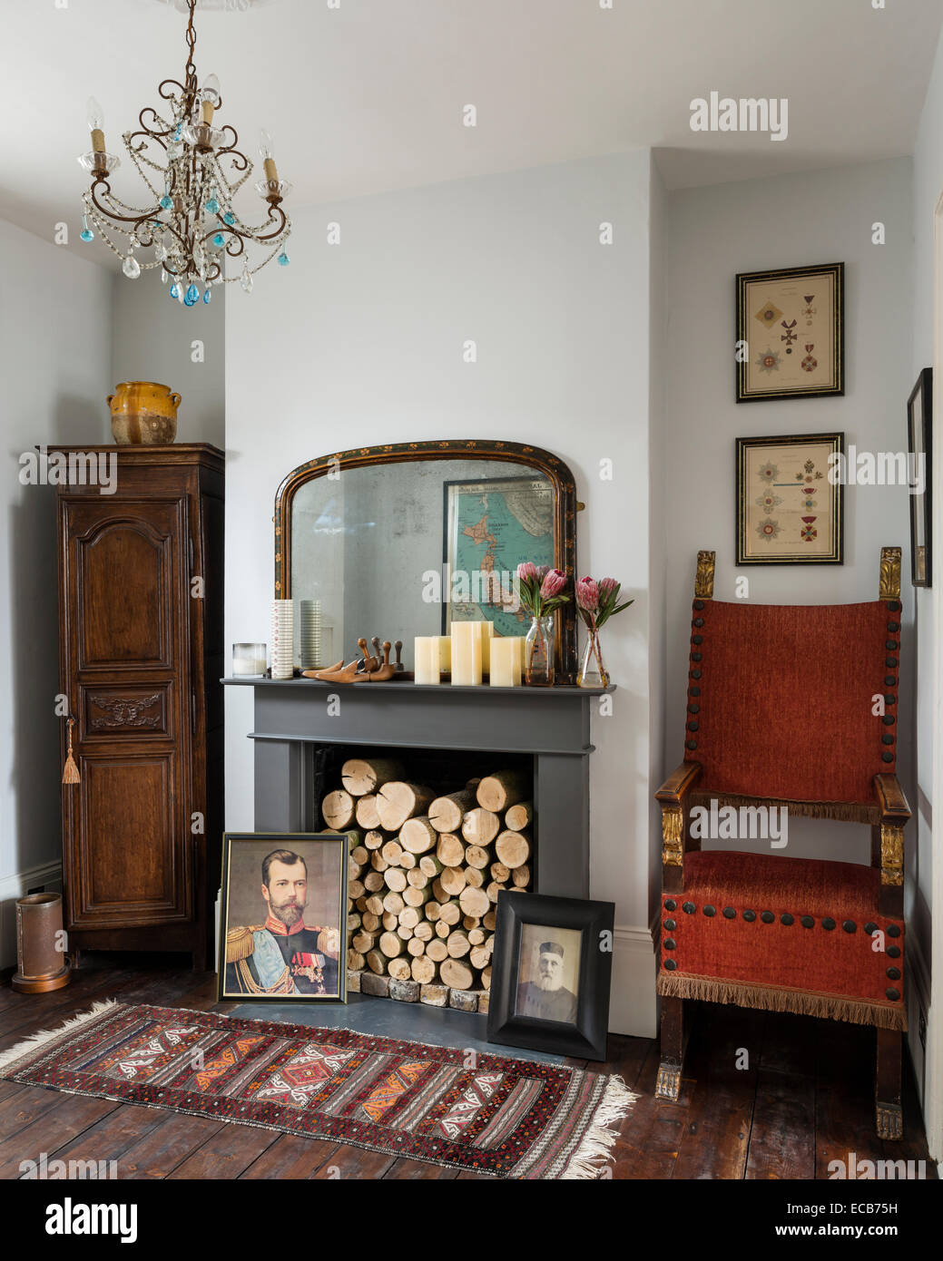 Vintage Rug On Wooden Floor In Front Of Fireplace With Logs And .