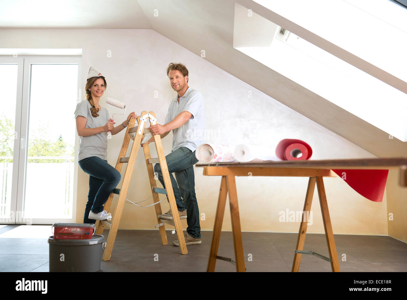 Woman Home Decorating man woman couple renovating home decorating stock photo, royalty