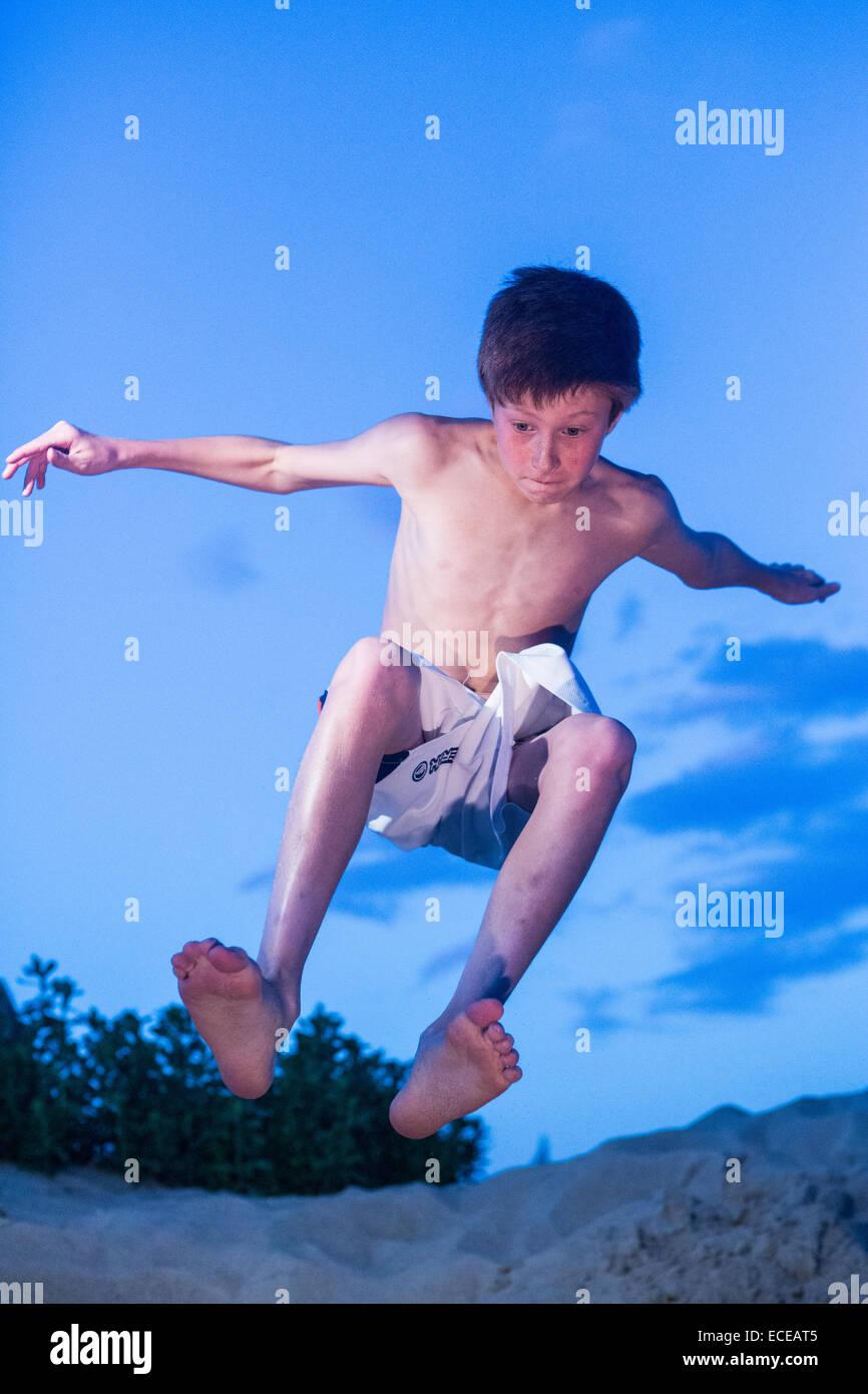 Redhead Boy On The Beach Jumping Air Speedo Teen