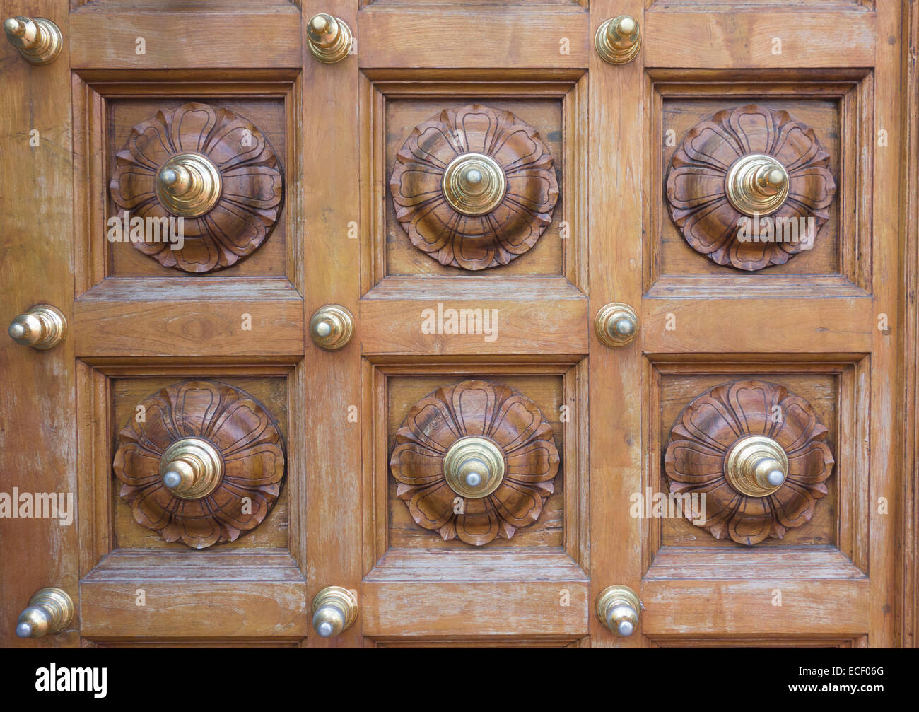 Ornate Carved Wood And Brass Design On A Temple Door