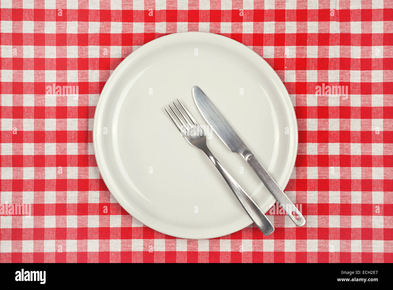 Empty Plate On Restaurant Table With Red And White Checkered Tablecloth
