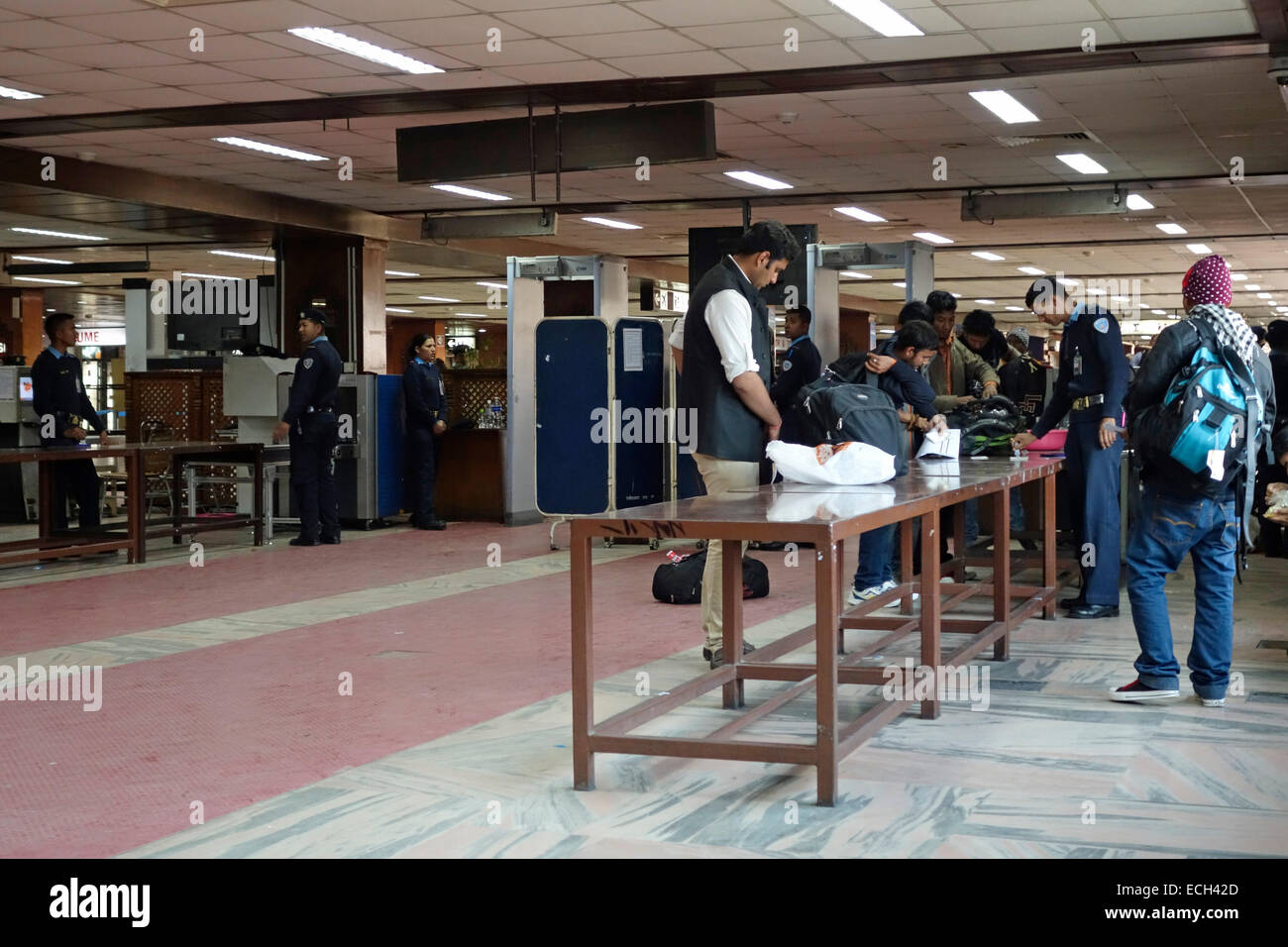 http://c8.alamy.com/comp/ECH42D/security-check-in-tribhuvan-international-airport-in-kathmandu-nepal-ECH42D.jpg