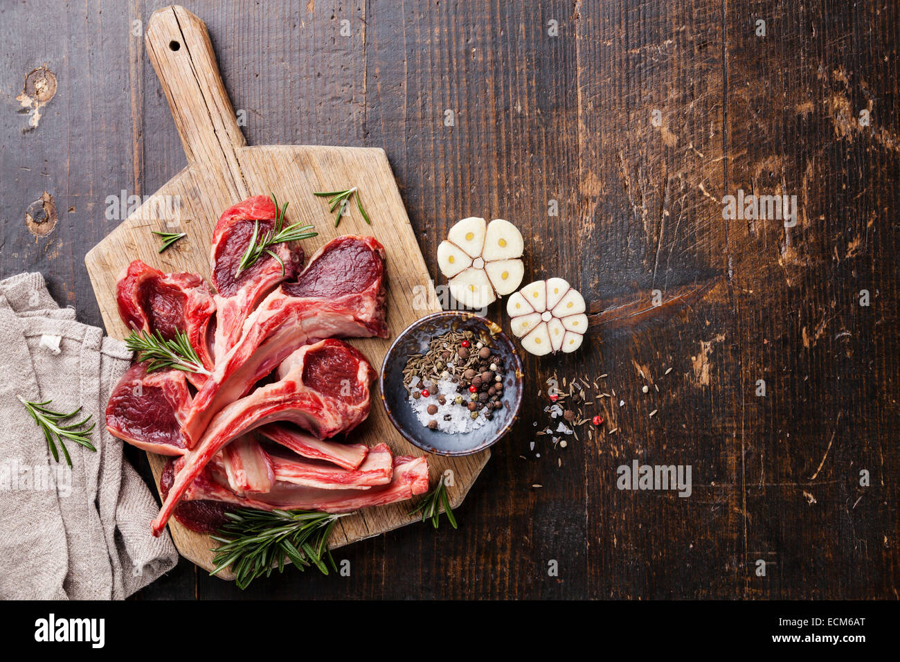 Raw fresh Lamb Meat ribs and seasonings on dark wooden background ... for Lamb Meat Photography  56mzq
