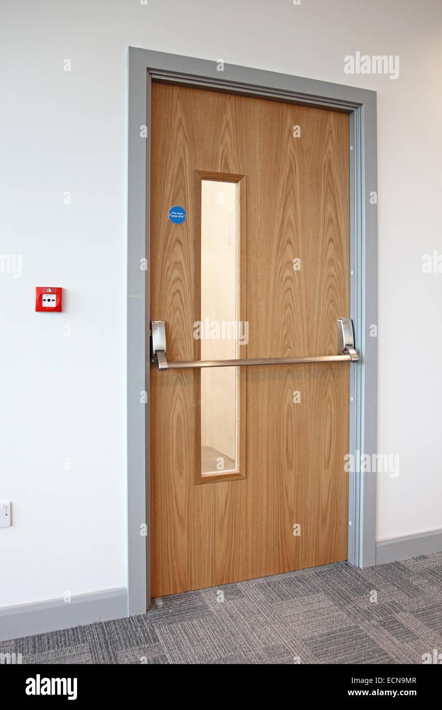 Oak Finished Fire Escape Door In A Modern Office Shows