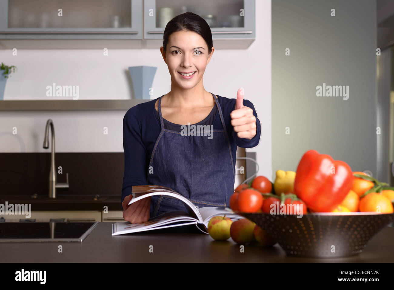 Happy middle-aged Woman Wearing Apron Standing at the Kitchen ...