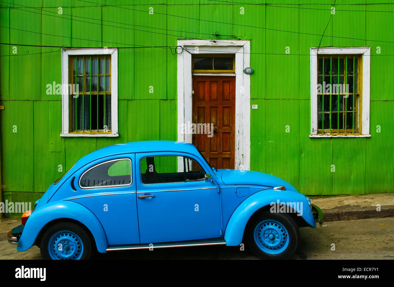 Bright Green House Bright Blue Volkswagen Beetle In Front Of A Green House In Valparaiso