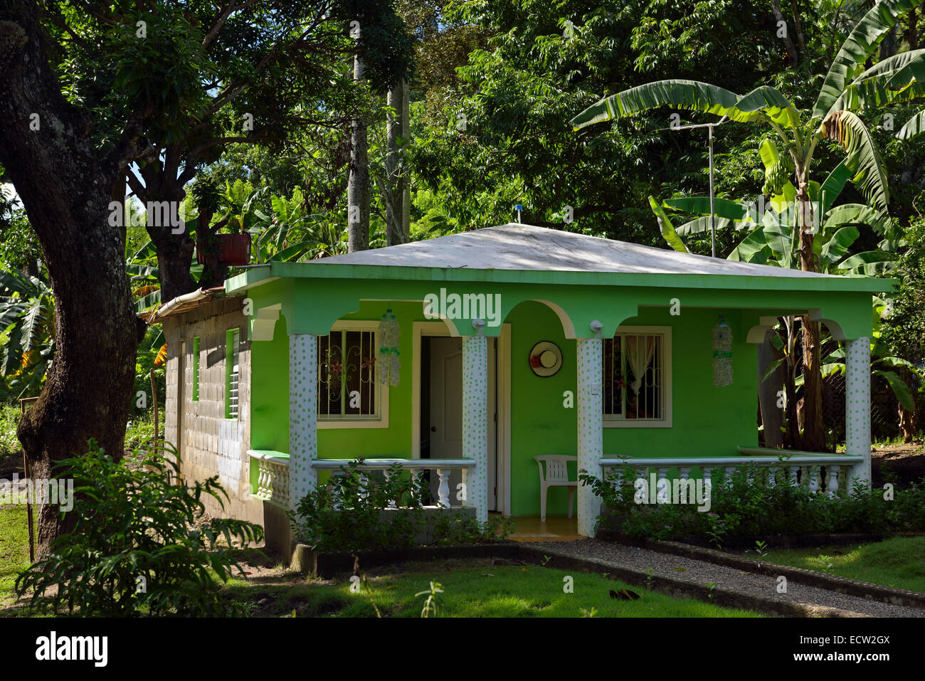 Rural Cinder Block House Painted Green In Dominican Republic With Garden  And Jungle   Stock Image