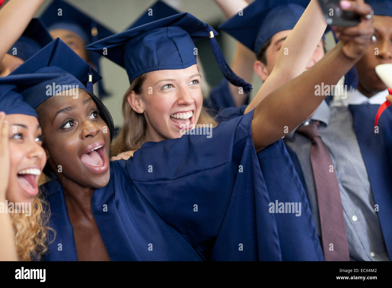 university students taking selfie after graduating stock photo stock photo university students taking selfie after graduating