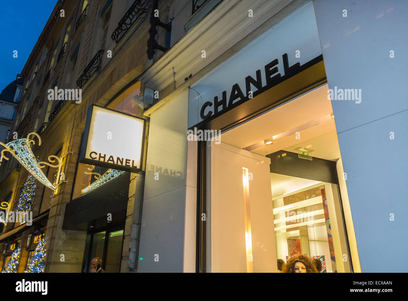 Paris street outside night luxury fashion brands window for Chanel locations in paris