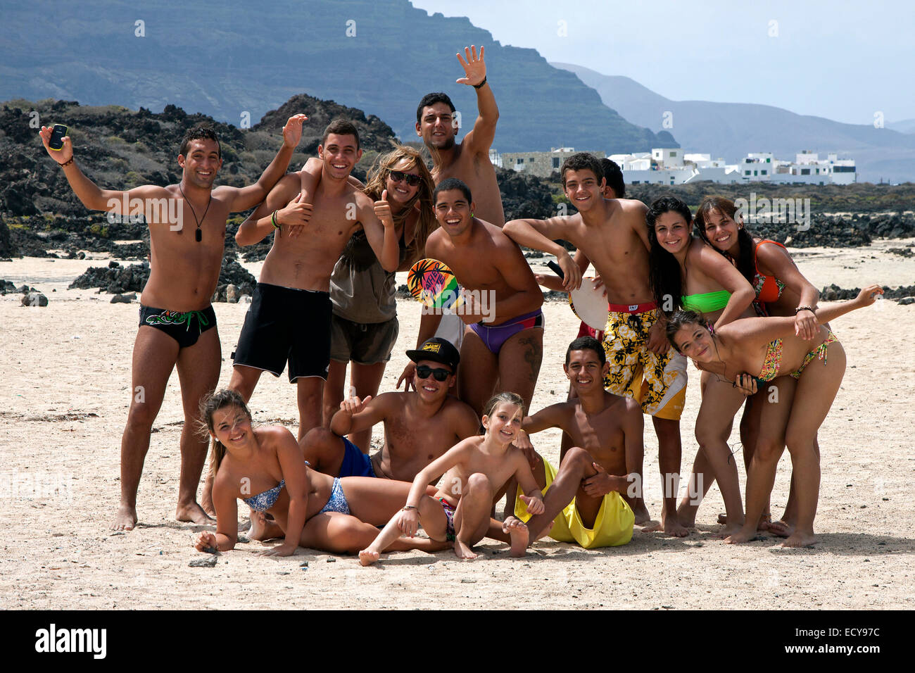 Group Of Young People On The Beach Bajo De Los Sables In Orzola Lanzarote Canary Islands Spain