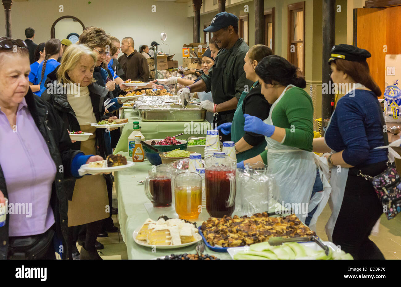 Volunteers serve lunch at the West Side Campaign Against Hunger