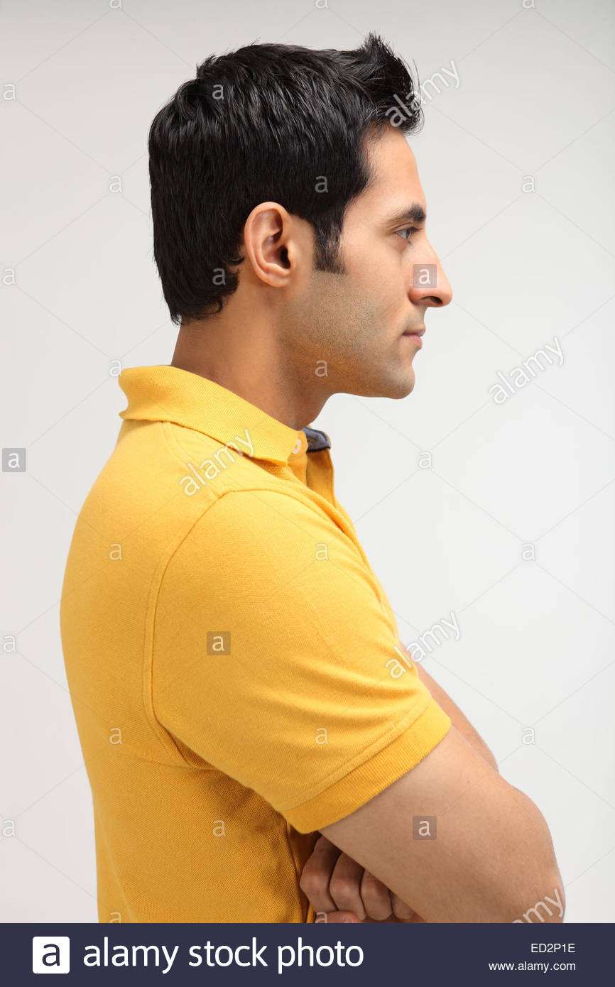 side profile of an indian man with his arms crossed stock. Black Bedroom Furniture Sets. Home Design Ideas