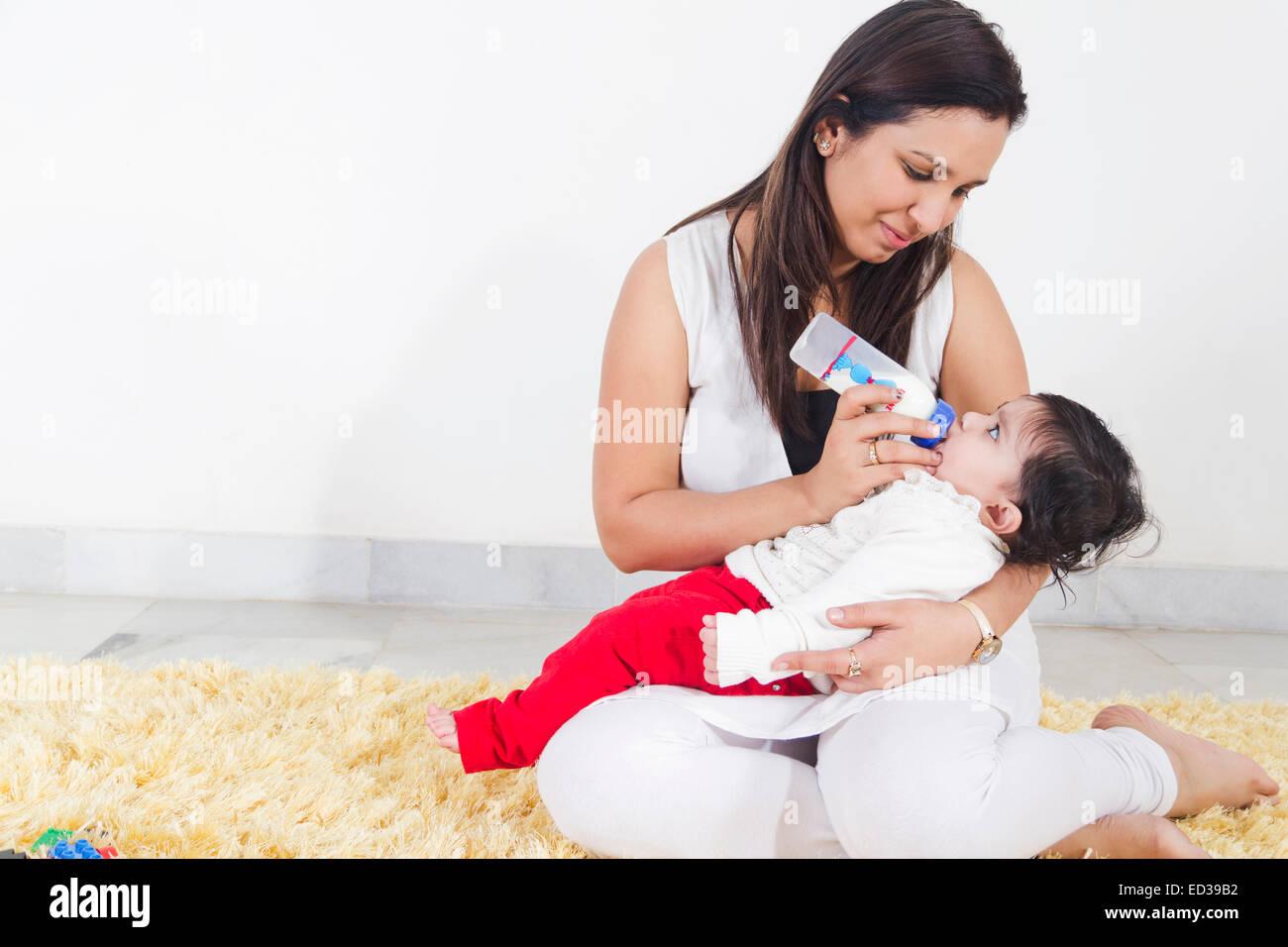 indian Mother New Beginning baby Feeding milk Stock Photo ...