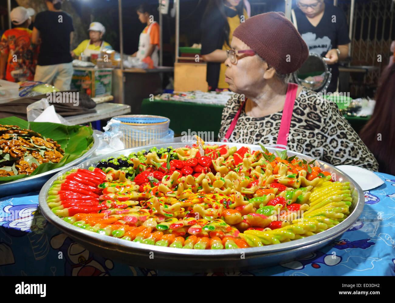 Older Woman, Thai Street Food. Vendor At Night Market, Offering Kao ...