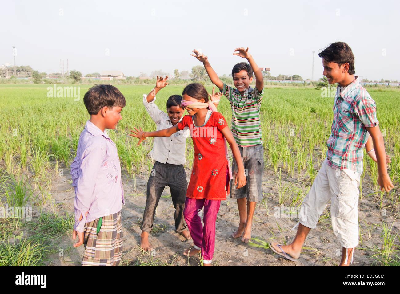Hide Seek Kids: Indian Rural Children Farm Playing Hide And Seek Stock