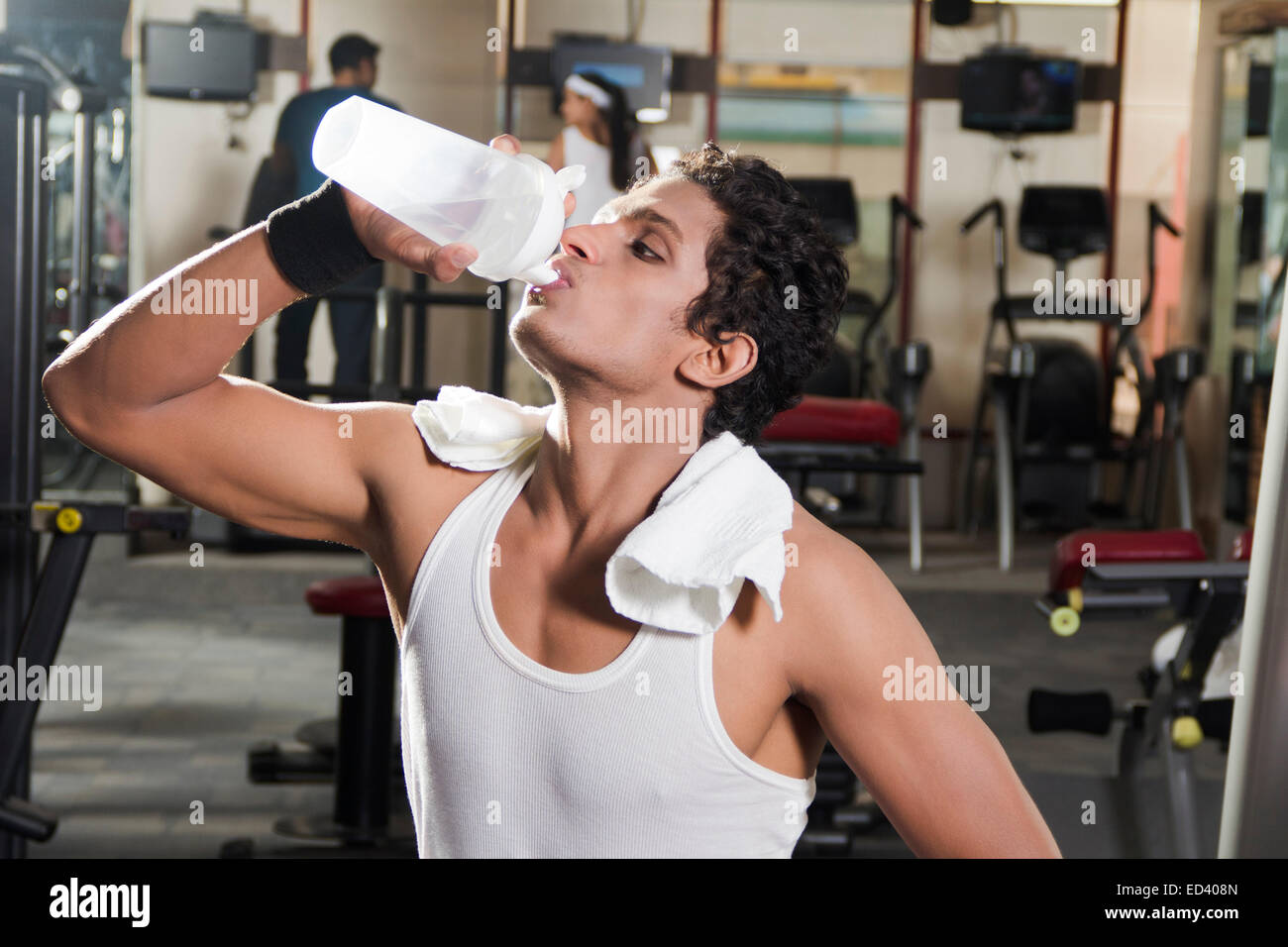 1 indian sports man gym drinking water stock photo royalty free 1 indian sports man gym drinking water sciox Choice Image