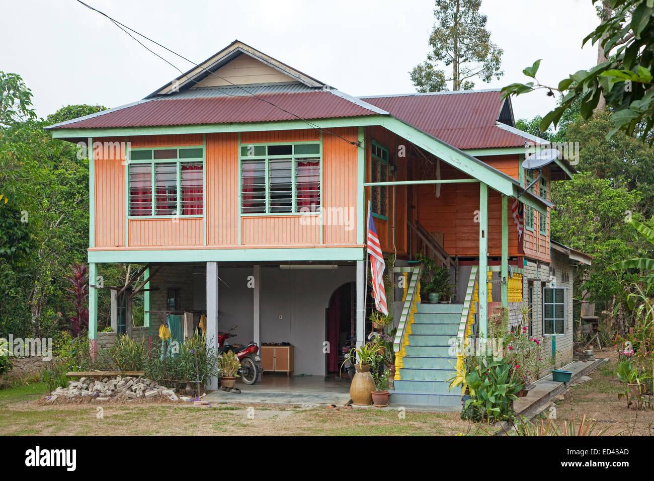 Modern malaysian wooden house on pillars in the countryside near taiping perak malaysia