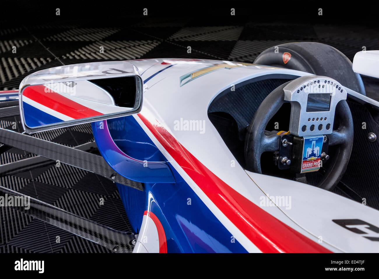 A cockpit view of a chevy powered indy racing league open wheel race a cockpit view of a chevy powered indy racing league open wheel race car on a dark floor and background voltagebd Images