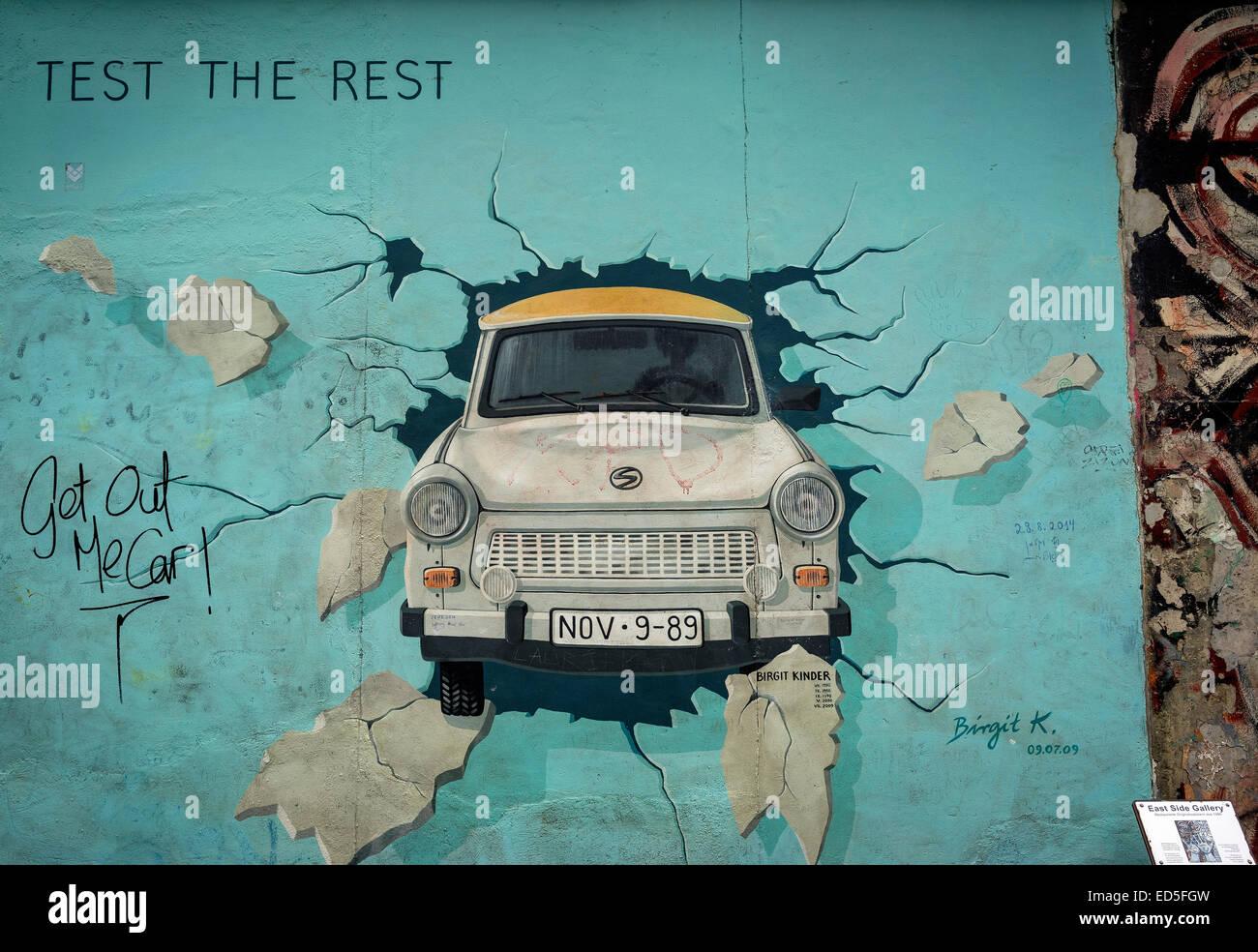 Berlin Wall Art trabant car graffiti art at berlin wall in germany stock photo