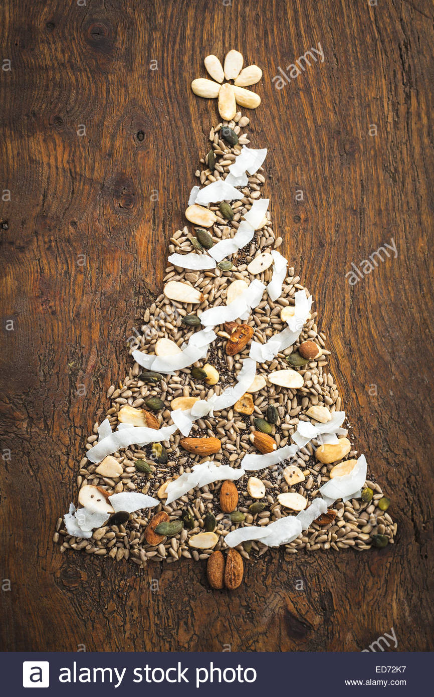 Christmas tree design made out of natural seeds, nuts and dried ...