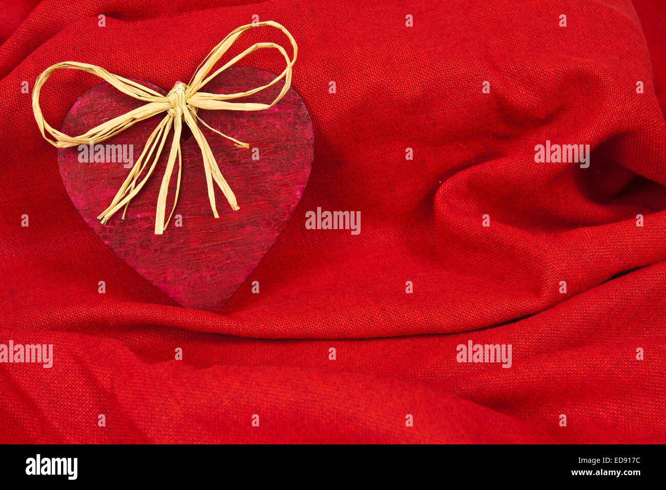 Wooden red heart on red cloth as a symbol of love stock photo wooden red heart on red cloth as a symbol of love biocorpaavc Images