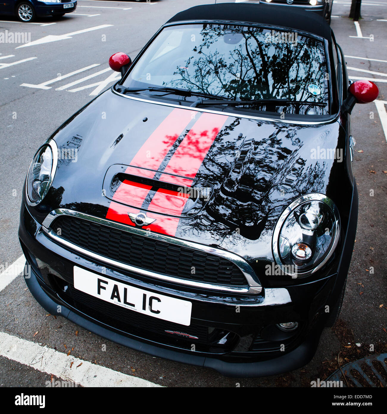 black convertible mini cooper car with red stripes and a. Black Bedroom Furniture Sets. Home Design Ideas