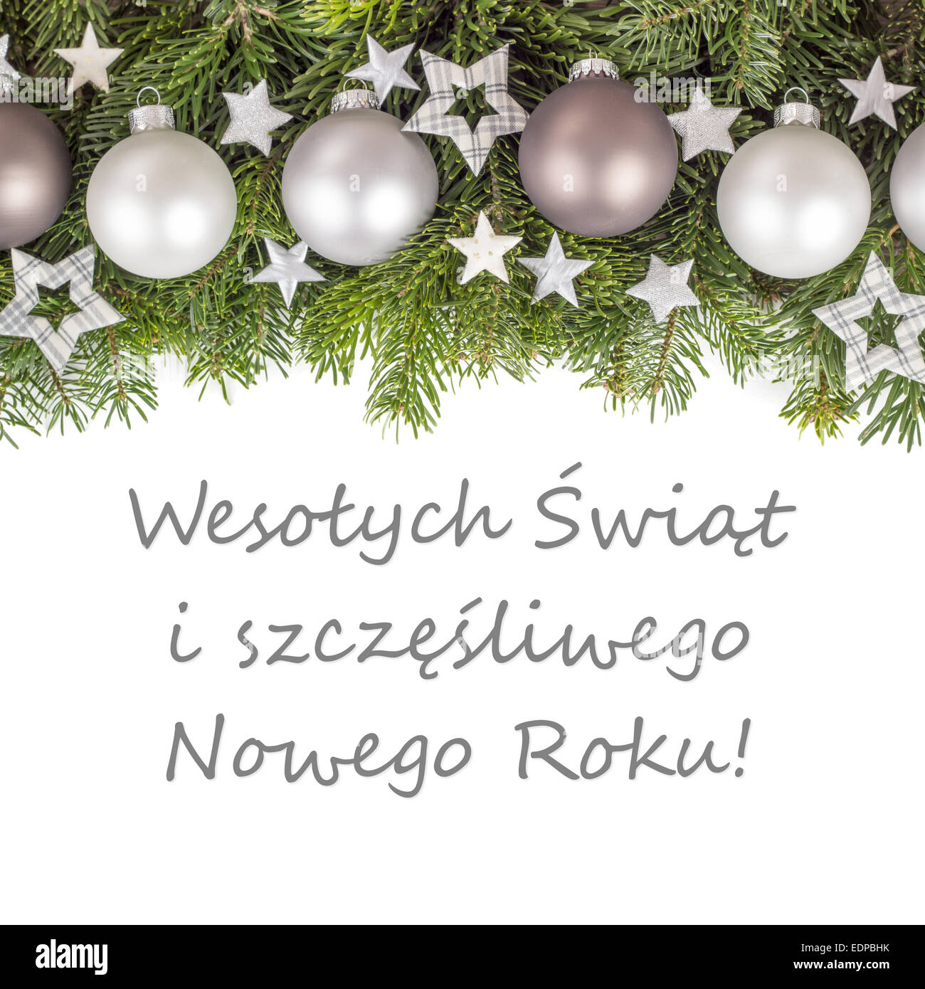 polish christmas card with christmas baubles fir branches golden stars and text merry christmas and a happy new year