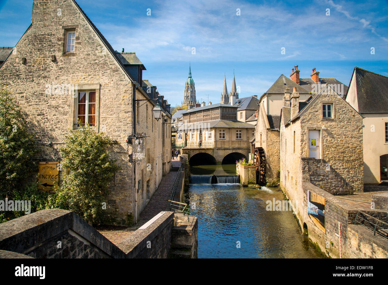 mill along river weir and medieval town of bayeux normandy france stock photo royalty free