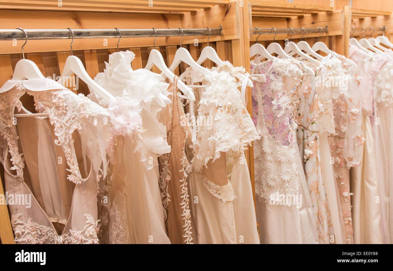 White Wedding Dresses Hanging On The Hanger